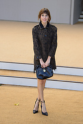 Arrivals for Burberry Prorsum Spring / Summer 2014. <br /> Alexa Chung arrives for the Burberry Prorsum Spring / Summer 2014 show, London, United Kingdom. Monday, 16th September 2013. Picture by Chris Joseph / i-Images