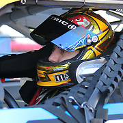 Sprint Cup Series driver Kyle Busch (18) as seen in the side view mirro at Daytona International Speedway on February 18, 2011 in Daytona Beach, Florida. (AP Photo/Alex Menendez)