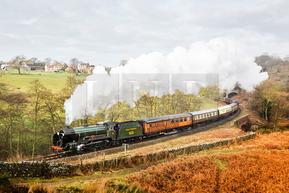 "© Licensed to London News Pictures. 18/02/2018. Goathland UK. The 1934 steam engine 926 ""Repton"" pulls the Pullman dinning service through the village of Goathland this morning in the North Yorkshire Moors on it's way to Pickering along the North Yorkshire Moors Railway. Photo credit: Andrew McCaren/LNP"