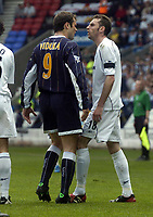 Photo. Glyn Thomas.<br /> Bolton Wanderers v Leeds United. <br /> FA Barclaycard Premiership. 02/05/2004.<br /> Leeds' Mark Viduka (L) exchanges angry words with Nicky Hunt, after which Viduka was shown the yellow card.