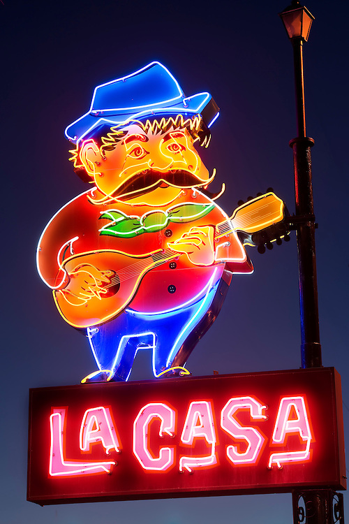 Now a city landmark, the neon sign for La Casa Pizzaria features the grandly mustachioed Peppi.