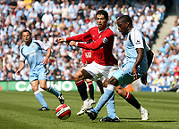 Photo: Paul Thomas.<br /> Manchester City v Manchester United. The Barclays Premiership. 05/05/2007.<br /> <br /> Nedum Onuoha (R) of City passes from Cristiano Ronaldo.