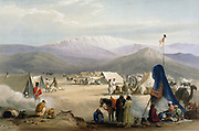 First Anglo-Afghan War 1838-1842: British army under canvas at Dadur at entrance to the Bolan Pass. Sioriab mountains in background. From J Atkinson 'Sketches in Afghanistan' London 1842. Hand-coloured lithograph.