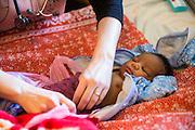 Dr Siobhan Neville examines a baby on the NICU (Neonatal Intensive Care Unit) Ward. St Walburg's Hospital, Nyangao. Lindi Region, Tanzania.