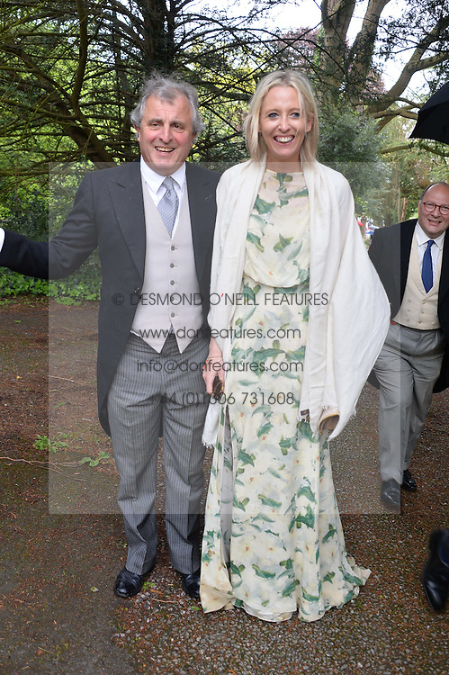 VISCOUNT ASTOR and the HON.SOPHIA HESKETH at the wedding of Princess Florence von Preussen second daughter of Prince Nicholas von Preussen to the Hon.James Tollemache youngest son of the 5th Lord Tollemache held at the Church of St.Michael & All Angels, East Coker, Somerset on 10th May 2014.