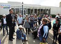 Community activist Jose Ibarra speaks to a crowd gathered outside City Hall on Tuesday after a fatal, officer-involved shooting close to the Sanborn Plaza Market in east Salinas.