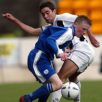 St Johnstone v St Mirren....26.04.03<br />Mark Baxter is tackled by Simon Lappin<br /><br />Picture by Graeme Hart.<br />Copyright Perthshire Picture Agency<br />Tel: 01738 623350  Mobile: 07990 594431