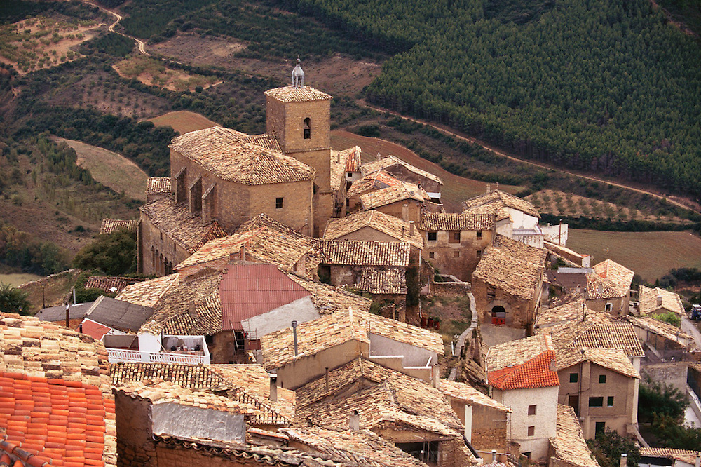 The crumbling village of Gallipienzo, in Navarra, Spain is built on the side of a hill and is utterly charming. The houses are built of stone and mortar. The old mortar is crumbling and is patched in places. Several of the homes are newly renovated but the owners kept the original ideas of the houses in place which is what is keeping the village charming.
