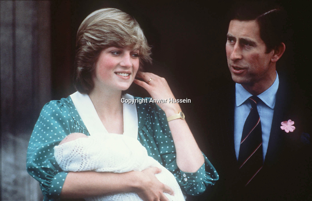 The Princess of Wales, wearing her favourite maternity dress, with newly-born baby Prince William and the Prince of Wales in June 1983.<br />