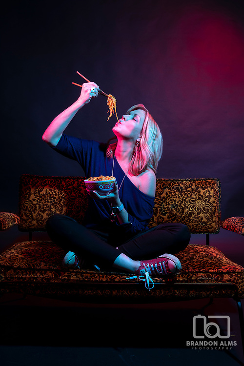 Portrait of a food lover in studio with colored gels. Photo by Brandon Alms