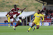 Northampton Town defender Gabriel Zakuani (6) and AFC Wimbledon striker Dominic Poleon (10) during the EFL Sky Bet League 1 match between Northampton Town and AFC Wimbledon at Sixfields Stadium, Northampton, England on 20 August 2016. Photo by Stuart Butcher.