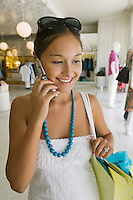 Girl Holding Using Cell Phone While Shopping