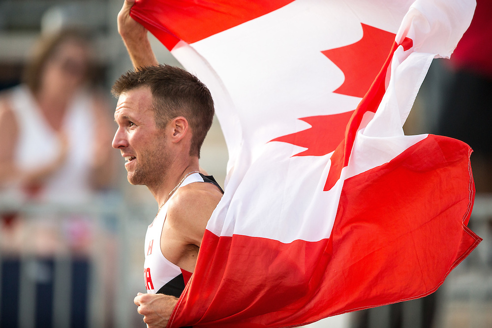 Nate Brannen of Canada celebrates following his silver medal win in the men's 1500 metres at the 2015 Pan American Games at CIBC Athletics Stadium in Toronto, Canada, July 24,  2015.  AFP PHOTO/GEOFF ROBINS