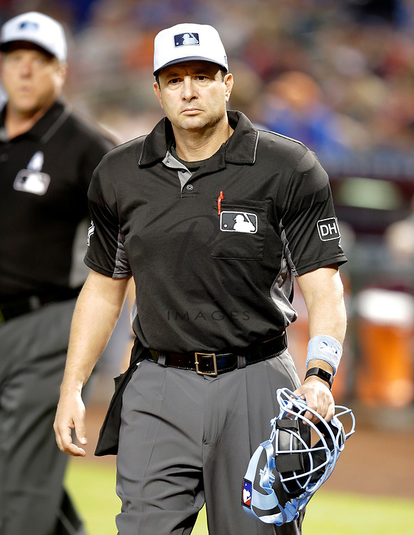 MLB umpire Jim Reynolds (77) in the first inning during a baseball game between the Arizona Diamondbacks and the New York Mets, Sunday, June 17, 2018, in Phoenix. (AP Photo/Rick Scuteri)