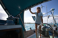 Patagonia ambassador Liz Clark at the helm. French Polynesia