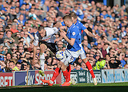 Notts County Defender Haydn Hollis takes on Portsmouth forward Michael Smith and Portsmouth striker Adam McGurk during the Sky Bet League 2 match between Portsmouth and Notts County at Fratton Park, Portsmouth, England on 25 March 2016. Photo by Adam Rivers.