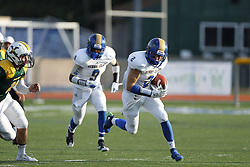 Henry Clay back Austin Bledsoe ran upfield for yards in the first half. Henry Clay hosted St. Xavier at Lexington Catholic High School, Friday, Aug. 28, 2015 in Lexington.