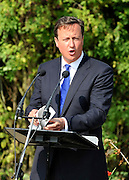 © licensed to London News Pictures.CARTERTON, UK.  01/09/11.David Cameron. A ceremony, attended by British Prime Minister David Cameron,  takes place at The Memorial Garden at Norton Way in Carterton, Oxfordshire today (01 Sept 2011). The Garden will become the focal point during the repatriation of UK service personnel from RAF Brize Norton. The Union Flag that used to fly at repatriations in Wooton Bassett was handed over and was blessed. . Mandatory Credit Stephen Simpson/LNP