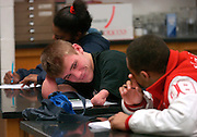 2006.02.02 HILLSBOROWRESTLER SPORTS : Hillsboro sophomore wrestler (center) Dustin Carter  reacts to his buddy (right) Kendal Coleman during their Biology class Thursday February 2, 2006. The Enquirer/Jeff Swinger
