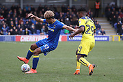 AFC Wimbledon striker Lyle Taylor (33) taking on Oxford United defender Ashley Smith-Brown (29) during the EFL Sky Bet League 1 match between AFC Wimbledon and Oxford United at the Cherry Red Records Stadium, Kingston, England on 10 March 2018. Picture by Matthew Redman.
