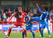 Crawley Town striker Matt Harrold wins possession against Leyton Orient midfielder Bradley Pritchard during the Sky Bet League 2 match between Crawley Town and Leyton Orient at the Checkatrade.com Stadium, Crawley, England on 10 October 2015. Photo by Bennett Dean.