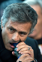 Inter Milan coach Jose Mourinho struggles to open a bottle of water. 24th October 2009.