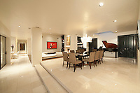 Spacious white living interior with grand piano