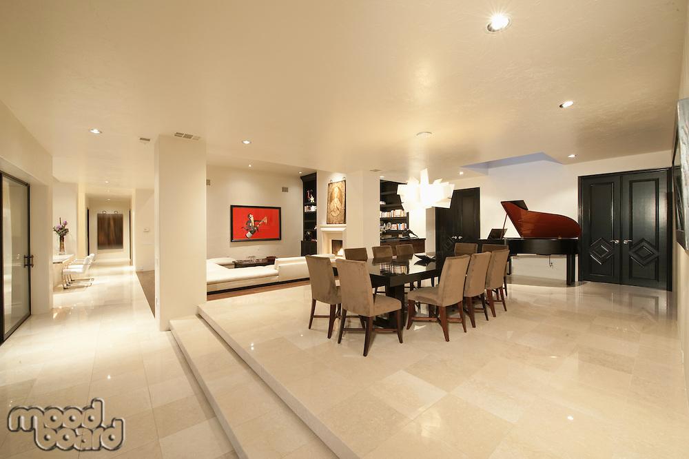 Spacious white living interior with grand piano