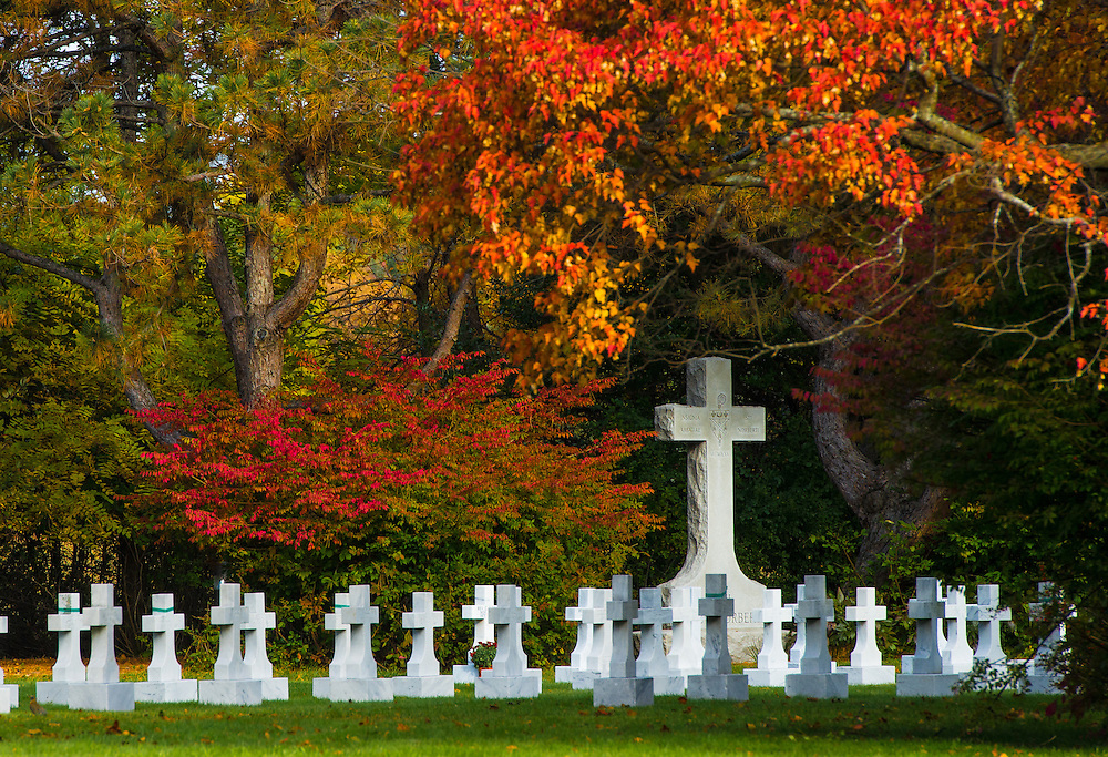 Fall colors paint a colorful background behind gravestones at St. Norbert Abbey cemetery in De Pere, Wis., Oct. 11. (Sam Lucero photo)