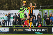 Forest Green Rovers Christian Doidge(9) beats Cambridge United's Harry Darling(25) in the air during the EFL Sky Bet League 2 match between Forest Green Rovers and Cambridge United at the New Lawn, Forest Green, United Kingdom on 20 January 2018. Photo by Shane Healey.