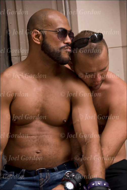 Bare chested, Alex and David, a tender affectionate moment, hugging, talking, waiting  before the start of the Pride Parade in NYC
