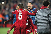 Liverpool midfielder Georginio Wijnaldum (5) and Liverpool defender Joel Matip (32) celebrate their 4-0 win during the Champions League semi-final, leg 2 of 2 match between Liverpool and Barcelona at Anfield, Liverpool, England on 7 May 2019.