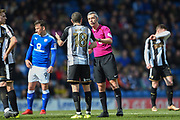 Referee Sebastian Stockbridge has words with Notts County midfielder Liam Noble (18) during the EFL Sky Bet League 2 match between Chesterfield and Notts County at the b2net stadium, Chesterfield, England on 25 March 2018. Picture by Jon Hobley.