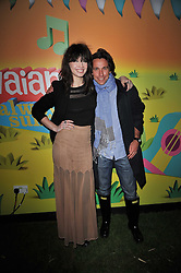 DAISY LOWE and ENO POLO President of the Alpargartas Group/Havalanas at a party to celebrate the global launch of the Iconic Brazilian lifestyle brand Havaianas Wellies range held at Selfridges, Oxford Street, London on 14th April 2011.