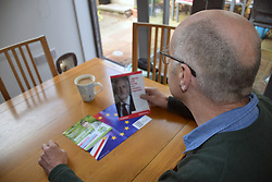 European Parliament Elections May 2019 - man reading various Labour Party political party leaflet. UK May 2019