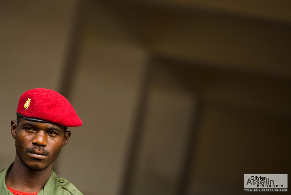 "A soldier stands guard during the visit of Guinea's president Captain Moussa Dadis Camara at the Kofi Annan private university in Conakry, Guinea on Thursday March 5, 2009. Camara, who took power after a coup in December 2008, was visiting the university to ""meet the youth"", as part of his efforts to solidify his support from Guinea's population.(Olivier Asselin for the New York Times)"