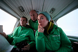 NORWAY BARENTS SEA 6DEC15 - Greenpeace campaigners Larissa Baeumer, Christian Bussau of Germany and Erlend Tellnes (L) of Norway during the survey flight to the production platform Goliat in the Barents Sea operated by Italian energy compay Eni. It is the world's most northerly oil production platform.<br /> <br /> jre/Photo by Jiri Rezac / Greenpeace<br /> <br /> © Jiri Rezac 2015