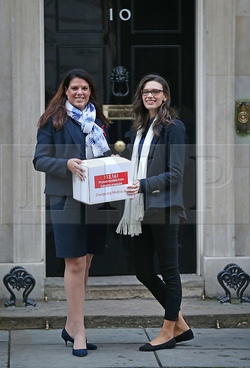 © Licensed to London News Pictures. 01/12/2015. London, UK. CAROLINE NOKES MP (L) stands with model ROSIE NELSON in Downing Street. Rosie is presenting a petition for a law that would protect young models from being pressurised into becoming dangerously thin. Photo credit: Peter Macdiarmid/LNP