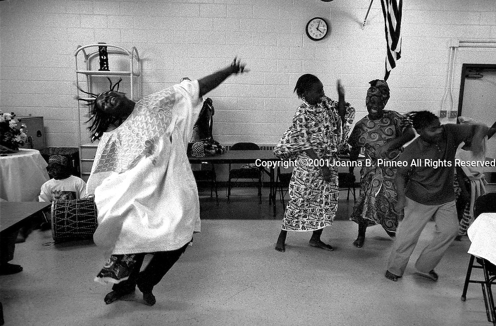 Dancer Femi Manners from Maryland instructs some of the girls in dance in Richmond, Virginia during a girls rites of passage weekend.
