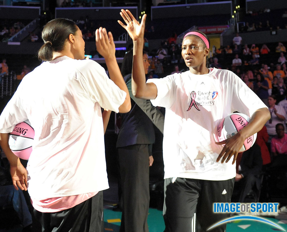 Aug 10, 2010; Los Angeles, CA, USA; Los Angeles Sparks forward DeLisha Milton-Jones (right) exhanges high fives with forward Lindsay Wisdom-Hylton before the game against the Indiana Fever at the Staples Center. Photo by Image of Sport