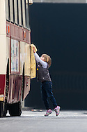 A child polishes a vintage bus before the St Patrick's Day Parade in Westminster, London.<br /> Picture by Paul Davey/Focus Images Ltd +447966 016296<br /> 13/03/2016