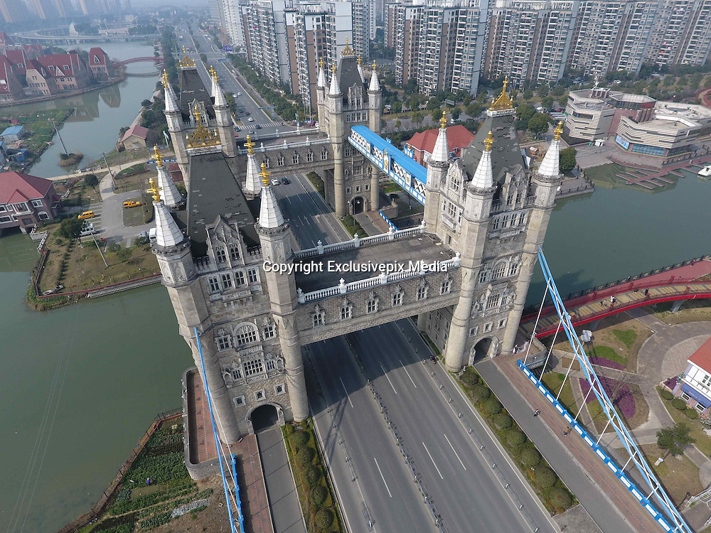 SUZHOU, CHINA - FEBRUARY 25: <br /> <br /> Bridge Resembling London Tower Bridge Built In China<br /> <br /> Cars run across the bridge resembling the London Tower Bridge on February 25 in Suzhou, Jiangsu Province of China. The bridge, built over Yuanhe Pond in Suzhou, insists of four 40-meter-tall towers which resemble the Tower Bridge in London.<br /> &copy;Exclusivepix Media