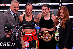 December 15, 2018 - New York, New York, USA - KATIE TAYLOR (solid black trunks with gold trim) and EVA WAHLSTROM pose together after their bout for the IBF and WBA womenÃ•s lightweight titles at Madison Square Garden in New York, New York. (Credit Image: © Joel Plummer/ZUMA Wire)