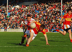 Ballintubber's Gary Loftus in action against Castlebar Mitchels Neil Douglas during the County senior football final...Pic Conor McKeown
