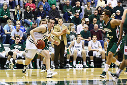 17 December 2011:  Jordan Zimmer breaks for the lane during an NCAA mens division 3 basketball game between the Washington University Bears and the Illinois Wesleyan Titans in Shirk Center, Bloomington IL