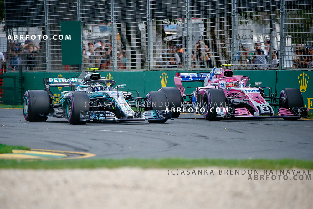 Mercedes driver Valtteri Bottas of Finland overtakes Force India driver Esteban Ocon of France during the 2018 Rolex Formula 1 Australian Grand Prix at Albert Park, Melbourne, Australia, March 24, 2018.  Asanka Brendon Ratnayake