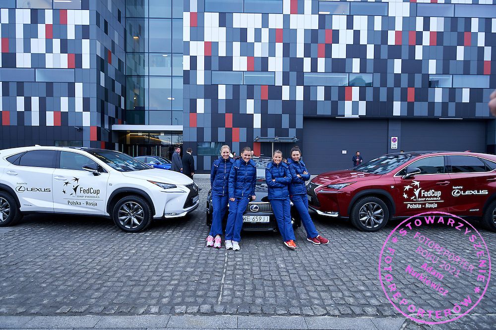 (L-R) Urszula Radwanska and Agnieszka Radwanska and Alicja Rosolska and Klaudia Jans Ignacik all from Poland pose with Lexus - official transport cars after official draw one day before the Fed Cup / World Group 1st round tennis match between Poland and Russia at Holiday Inn on February 6, 2015 in Cracow, Poland.<br /> <br /> Poland, Cracow, February 6, 2015<br /> <br /> Picture also available in RAW (NEF) or TIFF format on special request.<br /> <br /> For editorial use only. Any commercial or promotional use requires permission.<br /> <br /> Adam Nurkiewicz declares that he has no rights to the image of people at the photographs of his authorship.<br /> <br /> Mandatory credit:<br /> Photo by &copy; Adam Nurkiewicz / Mediasport
