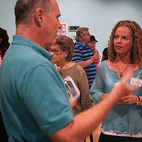 Mark Reilly, left, talks to Dayna Hines during the Wilmington Vegan Dining Guide Release Celebration Sunday August 3, 2014. The event featured vegan doses by local restaurants and businesses and a silent auction. (Jason A. Frizzelle)