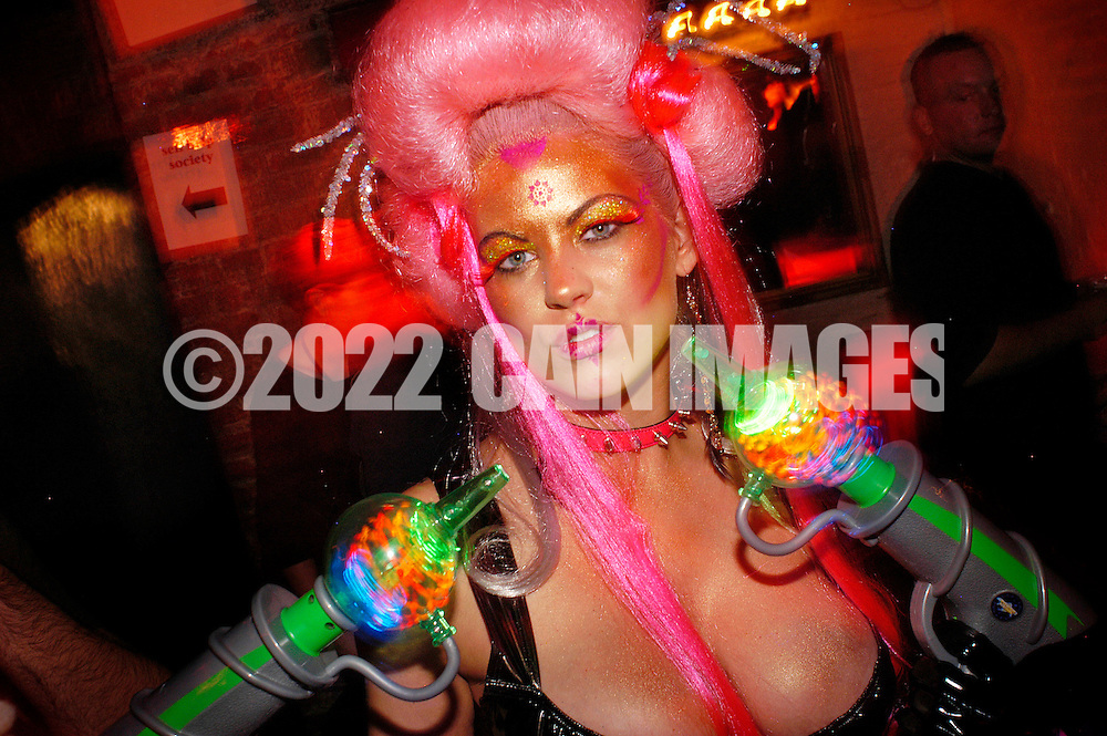 PHILADELPHIA - NOVEMBER 12: Courtney Shinsky, of Pierre & Carlo's in Philadelphia, Pennsylvania holds up her ray guns during Hairball 9 at Shampoo Niteclub November 12, 2005 in Philadelphia, Pennsylvania. Hairball, which is the East Coast's largest annual hair design competition featured models sporting outrageous themed hair designs and parade the catwalk. All proceeds from the event will benefit cancer and HIV/AIDS research and treatment at the world-renowned City of Hope National Medical Center and Beckman Research Institute. (Photo by William Thomas Cain/photodx.com)