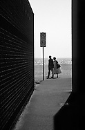 Couple Walking Sea Front, East Coast England - 1998